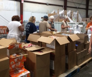 (NBC Covenant Partners in Birmingham, AL packing food for children in need.)